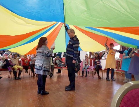 Under the parachute in messy church